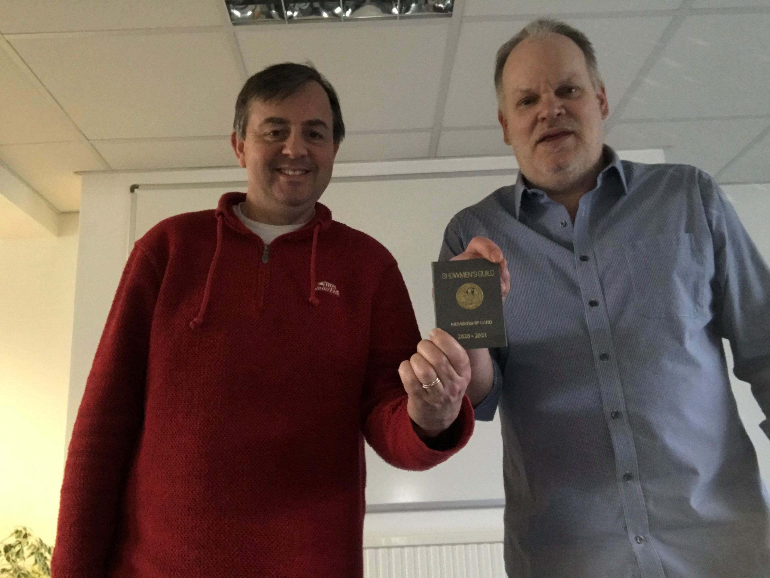 Oliver Burt and John Lowe holding their Showmen's Guild Membership Card